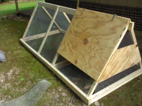 We added the top of the coop, and a lot of the hardware cloth. Still missing the door.